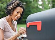 woman checking mailbox